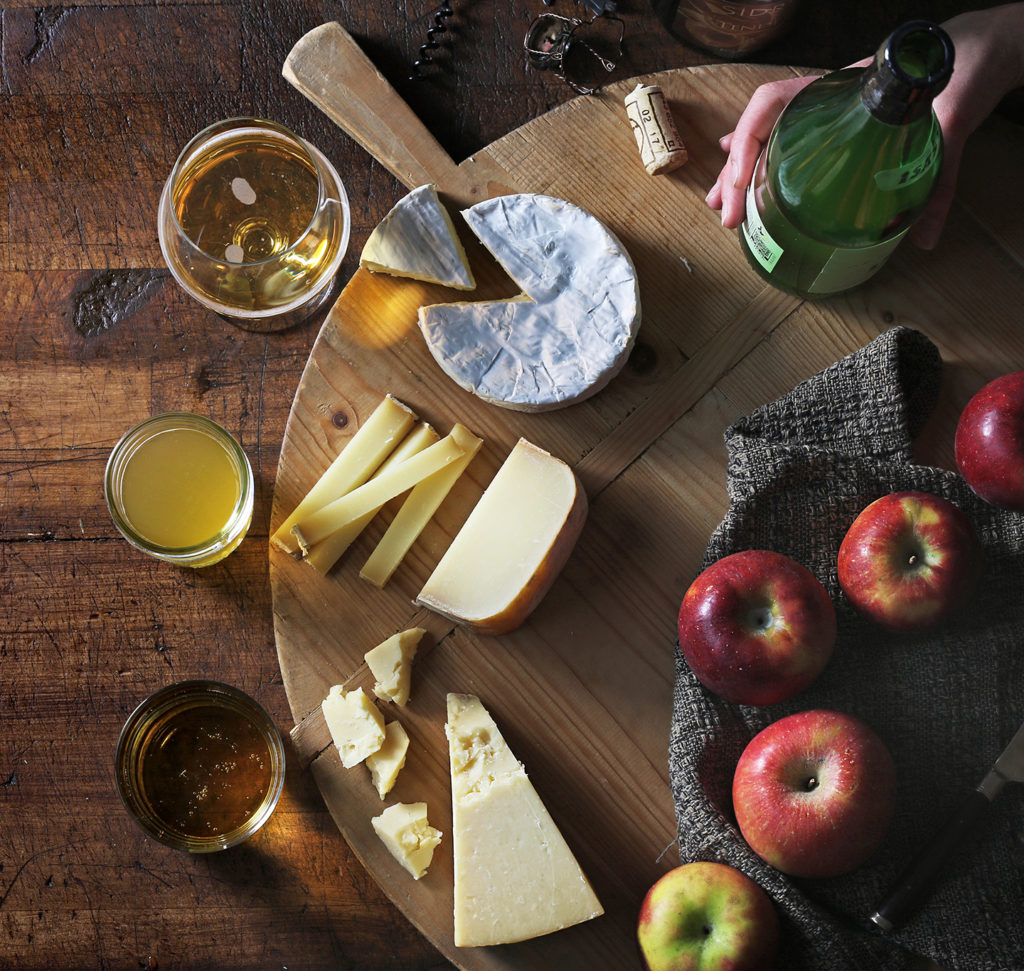 https://blog.murrayscheese.com/wp-content/uploads/2017/10/Cider-and-cheese-pairing-blog-1024x971.jpg